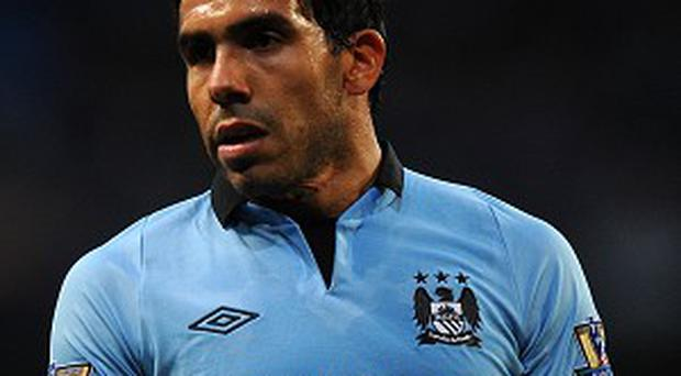 Carlos Tevez is set to head to Italy to discuss terms with Juventus