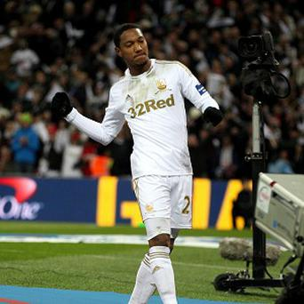 Jonathan de Guzman celebrates one of the eight goals he scored for Swansea last season