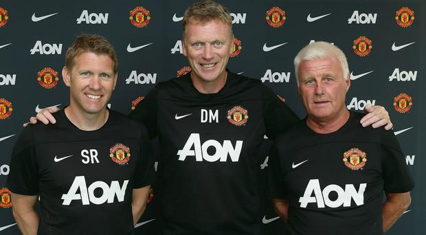 Manchester United manager David Moyes poses with assistant manager Steve Round (left) and coach Jimmy Lumsden on his first day in the job at Carrington
