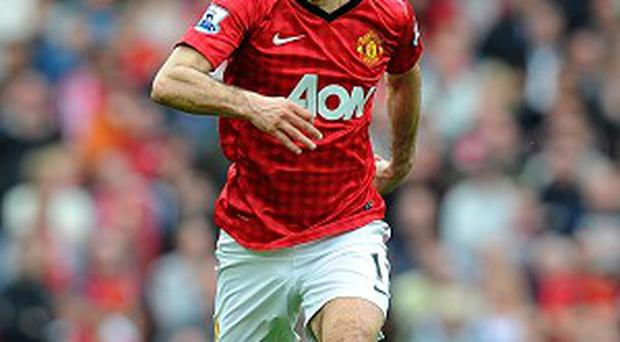 Ryan Giggs, pictured, and Phil Neville have been added to Manchester United's coaching staff