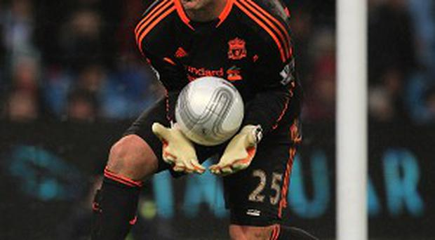 Jose Reina, pictured, still has a Liverpool future according to Brendan Rodgers