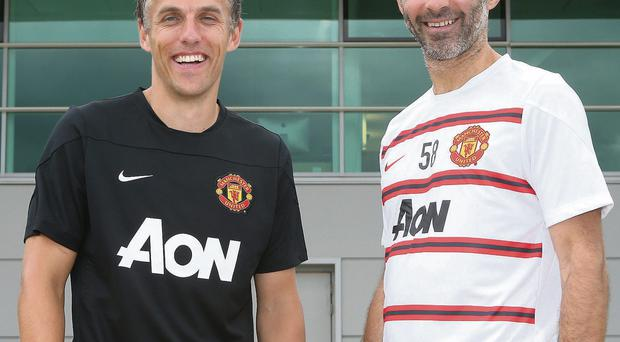 Phil Neville and Ryan Giggs – who have 19 Premier League titles between them with Manchester United – were yesterday appointed coaches at the club