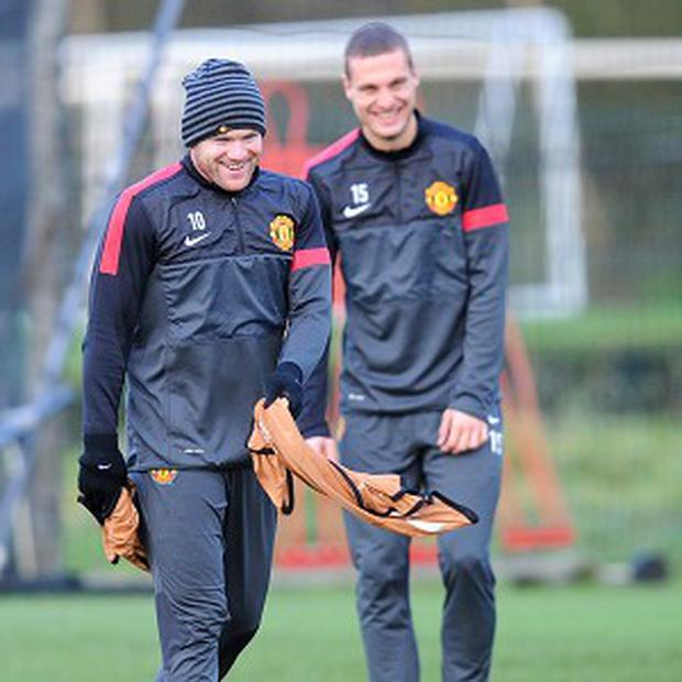 Nemanja Vidic has spoken to Wayne Rooney about the striker's future