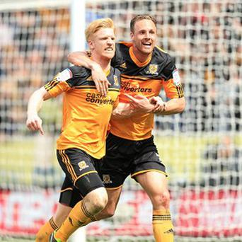 Paul McShane, left, has extended his stay at the KC Stadium