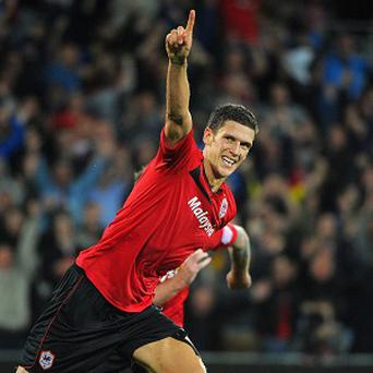 Cardiff's captain Mark Hudson has signed a new two-year deal