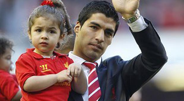 Arsenal hope to lure Suarez away from Anfield