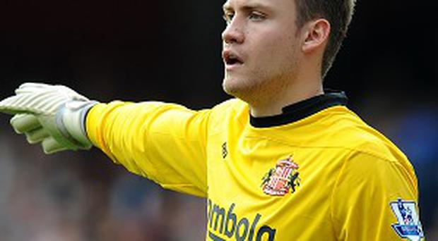 Simon Mignolet, pictured, wil be looking to dislodge Pepe Reina as Liverpool's first-choice keeper
