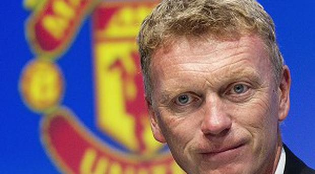 David Moyes, pictured, is treating Wayne Rooney's injury with caution
