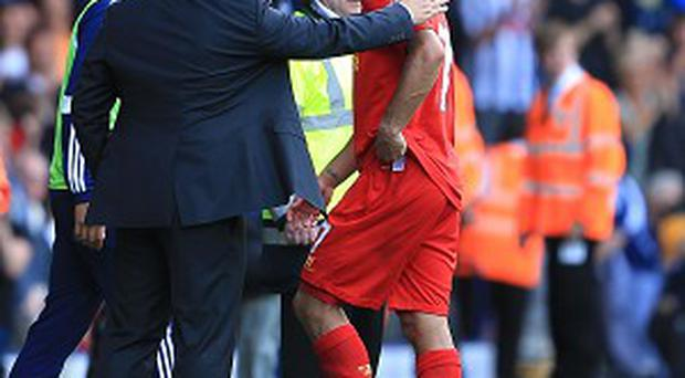 Brendan Rodgers, left, still hopes to keep hold of Luis Suarez
