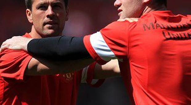 Michael Owen, left, was a team-mate of Wayne Rooney, right, at Manchester United
