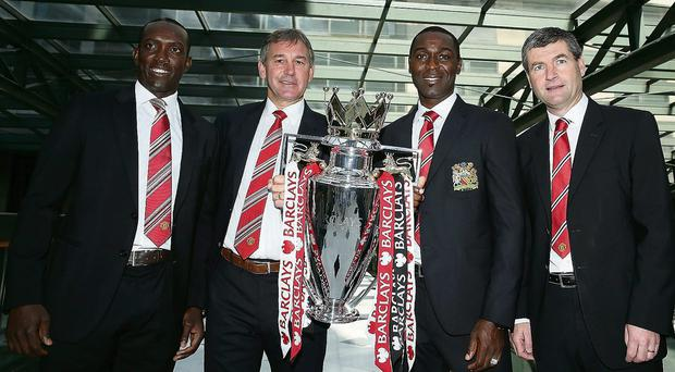 Dwight Yorke, Bryan Robson, Andy Cole and Dennis Irwin pictured with the Premier League trophy before a Manchester United lunch in Sydney yesterday