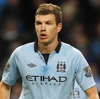 Edin Dzeko scored the only goal of the game against South China