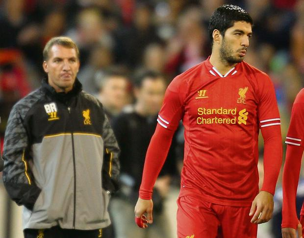 Liverpool FC Manager Brendan Rodgers (L) looks on as Luis Suarez of Liverpool is introduced during the match between the Melbourne Victory and Liverpool