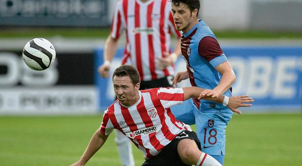 Paddy Kavanagh battles it out with Aykut Akgun at the Brandywell