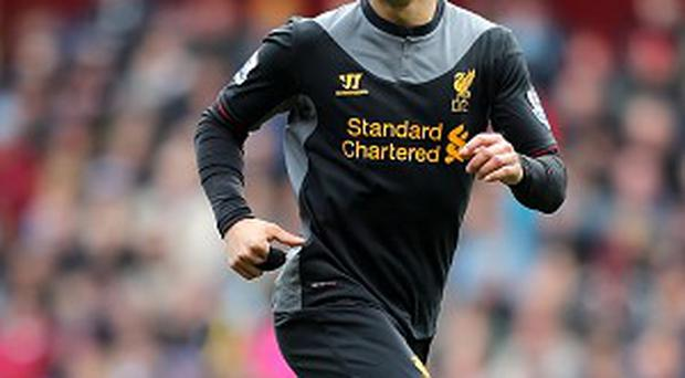 Luis Suarez is eager to play Champions League football