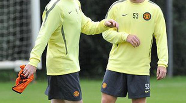 Paul Scholes, right, has urged Wayne Rooney to remain at Old Trafford