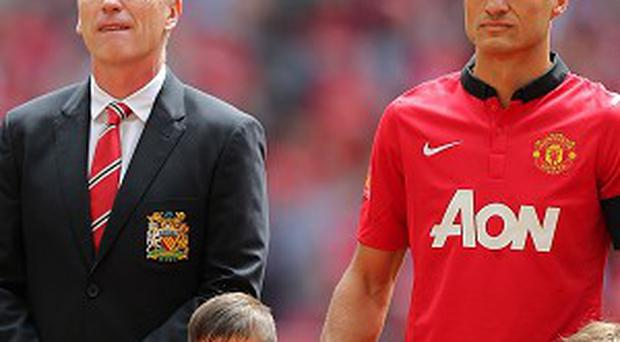 Nemanja Vidic, right, knows the pressure is on Manchester United this season