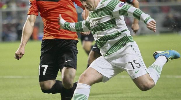 Shakhter's Andrei Poryvaev, left, battles with Celtic's Kris Commons during their Champions League play-off first leg clash in Kazakhstan