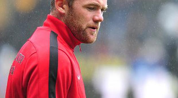 Jose Mourinho would not be drawn on whether he expects Wayne Rooney, pictured, to play against Chelsea