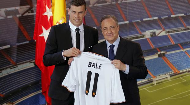 Gareth Bale, left, and Real Madrid President Florentino Perez - there is reported unrest among Real Madrid players at the sale of Mesut Ozil