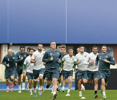 Robbie Keane and Richard Dunne lead the Irish squad during training at the Ernst Happel Stadium in Vienna yesterday