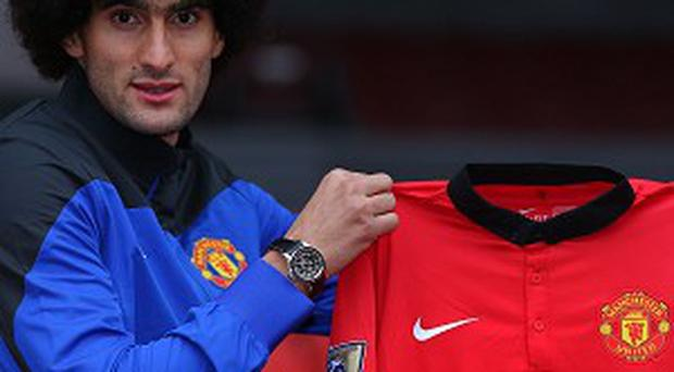 Marouane Fellaini was determined to push through his move to Old Trafford
