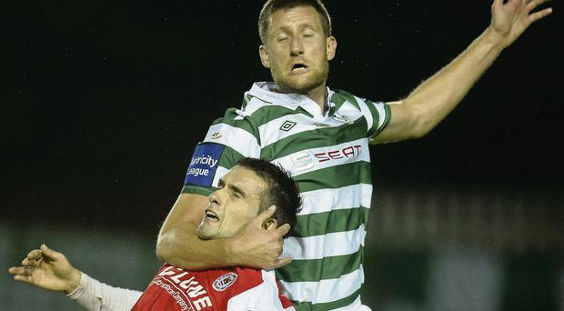 Shamrock Rovers centre-half Jason McGuinness gets to grips with Christy Fagan at Richmond Park DAVID MAHER / SPORTSFILE