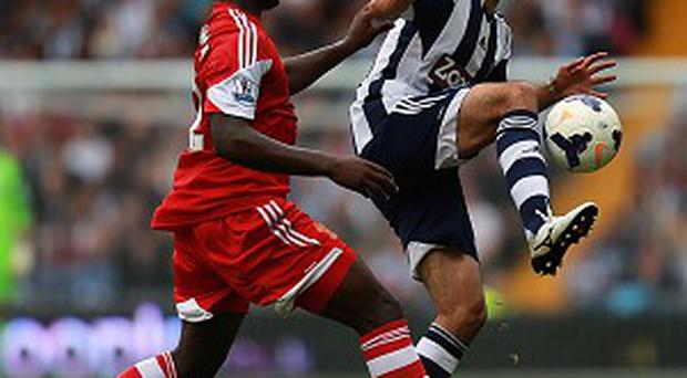 Victor Wanyama, left, is glad he made the move to the Premier League