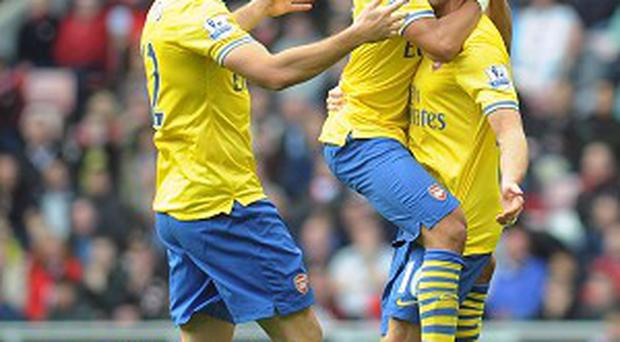 Aaron Ramsey, right, continued his impressive start to the season with two goals at Sunderland