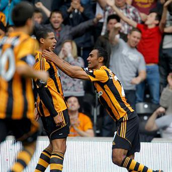 Curtis Davies celebrates scoring the opening goal