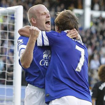 Steven Naismith, left, celebrates his goal with Nikica Jelavic
