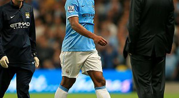 Vincent Kompany, centre, picked up his groin injury against Newcastle