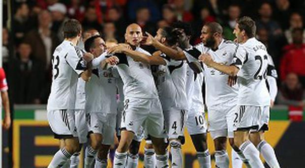 Jonjo Shelvey, centre, celebrates Swansea's opening goal before going on to have a mixed evening