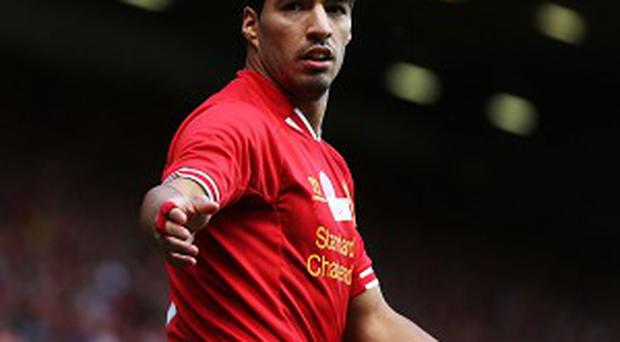 Luis Suarez will be free to pull on a Liverpool shirt in next Wednesday's Capital One Cup trip to Manchester United