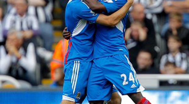 Sone Aluko, right, celebrates scoring the winning goal