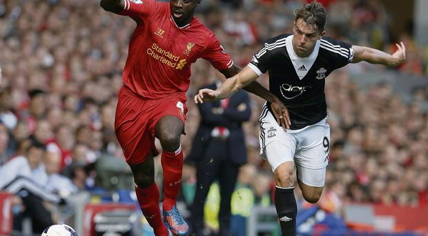 Kolo Toure battles it out with Rodriguez at Anfield