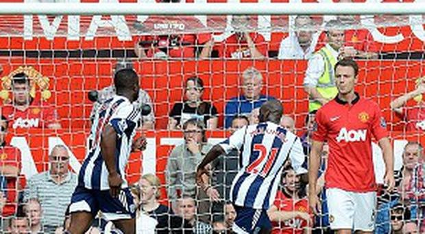Saido Berahino, left, runs away in delight after scoring the winner at Old Trafford
