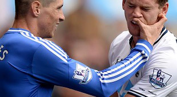 Fernando Torres, left, could have easily been sent off for his first spat with Jan Vertonghen, right