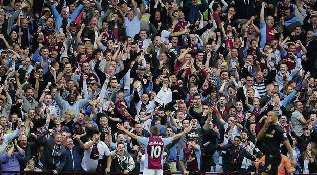 Aston Villa player Andreas Weimann takes the applause of the Holte end after scoring the third Villa goal during the Barclays Premier League match between Aston Villa and Manchester City at Villa Park