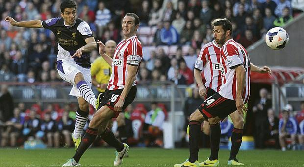 Liverpool's Luis Suarez has a shot on goal during the Barclays Premier League match at the Stadium of Light, Sunderland