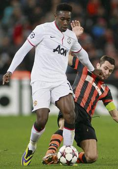 Man United's goalscorer Danny Welbeck is tackled by Shakhtar Donetsk's Darijo Srna