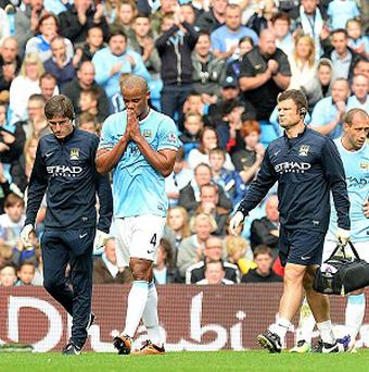 Vincent Kompany, centre, has a thigh problem