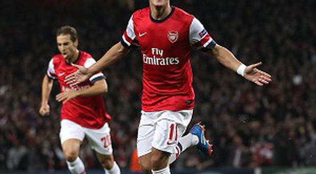 Mesut Ozil thinks it is premature to suggest that Arsenal will win the Premier League this season