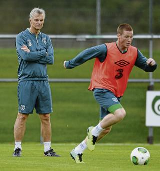 FAI High Performance Director Ruud Dokter keeps a close eye on James McCarthy during training this week – the Dutchman insists Ireland's style of play must evolve