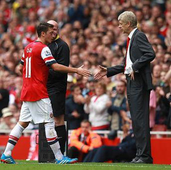 Mesut Ozil, left, has been impressed with Arsene Wenger, right, since joining Arsenal