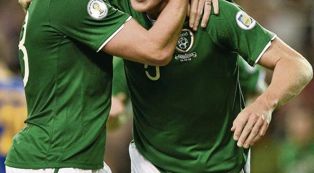 John O'Shea celebrates with team-mate Richard Dunne after scoring in Ireland's last game against Kazakhstan