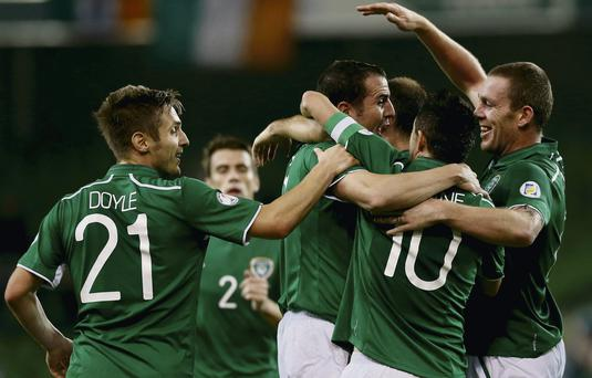 John O'Shea is congratulated by team-mates after scoring his side's second goal