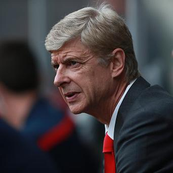 Arsene Wenger knows it is too early to rule Manchester United out of the title race