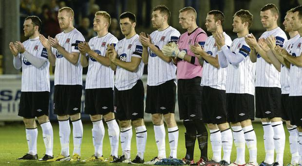 Dundalk's players join in a minute's applause in memory of Tommy McConville