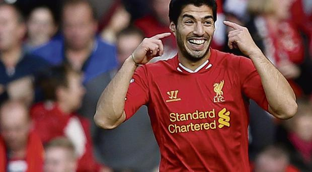 Liverpool's Luis Suarez celebrates after scoring his second goal during their 4-1 Premier League win over West Brom at Anfield yesterday. Photo: Phil Noble